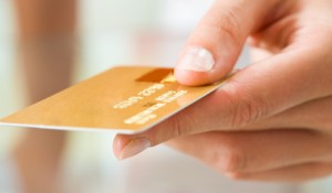 credit_card_in_hand-0d2423c8ef8c1b4ae469a0dd18b9973f