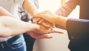 Concept of teamwork: Close-Up of hands business team showing un