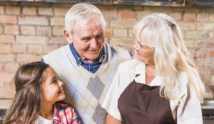 grandparents-with-granddaughter-in-kitchen_23-2147947827