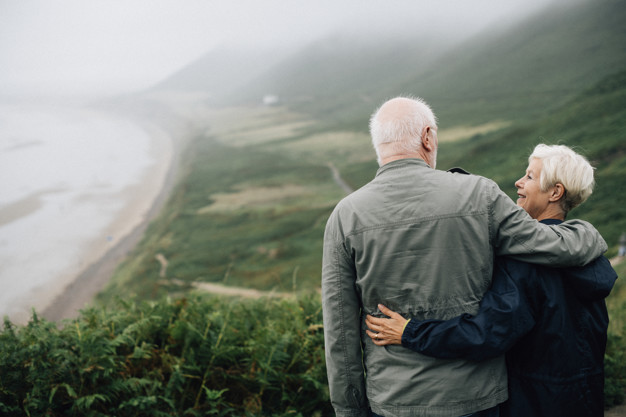 happy-senior-couple-enjoying-a-breathtaking-view_53876-63334