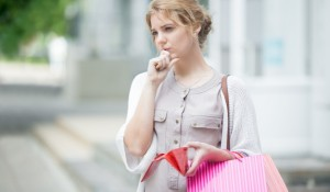 pensive-girl-holding-her-purse_1163-66