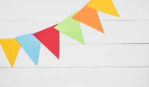 colorful-triangular-bunting-white-wooden-plank_23-2147889733