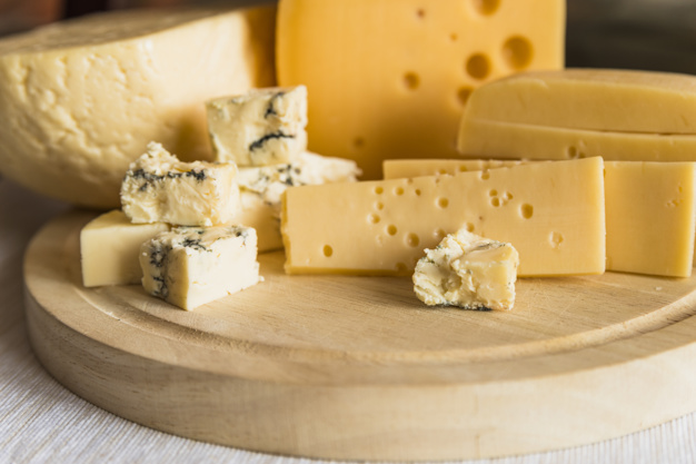 set-fresh-cheese-wood-chopping-board_23-2148037533
